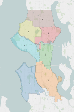 The city council consists of two at-large positions and seven district seats representing the areas shown.
