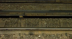 Conductor rail on the MBTA Red Line at South Station in Boston, consisting of two strips of aluminium on a steel rail to assist with heat and electrical conduction