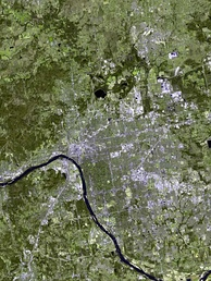 As seen from space, most of Tulsa lies east of the Arkansas River.