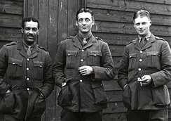 Walter Tull, professional footballer and the first mixed-heritage British Army officer. Pictured with fellow officers.