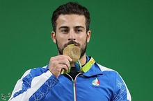Weightlifter Kianoush Rostami wins gold at the 2016 Summer Olympics.
