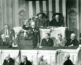 Winston Churchill addresses Congress in 1943. Sitting behind him Vice President Wallace and Speaker Rayburn.