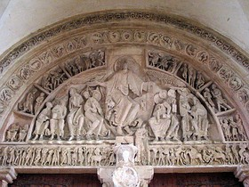 The tympanum of the inner portal of la Madeleine Vezelay has the scene of Christ in Majesty, at the Last Judgement. The figure of Christ is highly formalised in both posture and treatment. (1130s)