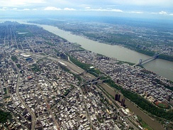An aerial view of the Bronx, Harlem River, Harlem, Hudson River, and George Washington Bridge