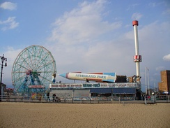 The Wonder Wheel and Astroland Park from a Coney Island beach