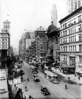 "Broadway north from 38th St., New York City, showing the Casino and Knickerbocker Theatres (""Listen, Lester"", visible at lower right, played the Knickerbocker from December 23, 1918, to August 16, 1919), a sign pointing to Maxine Elliott's Theatre, which is out of view on 39th Street, and a sign advertising the Winter Garden Theatre, which is out of view at 50th Street. All but the Winter Garden are demolished. The old Metropolitan Opera House and the old Times Tower are visible on the left."