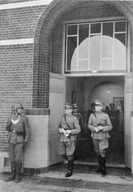 Winkelman, in the centre, leaves the school building in which the negotiations took place.