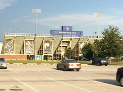 Delaware Stadium (pictured in 2014), where Nagy played college football for the Fightin' Blue Hens[18]