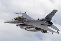 F-16C of the South Carolina Air National Guard in-flight over North Carolina equipped with air-to-air missiles, bomb rack, targeting pods and Electronic Counter Measures pods