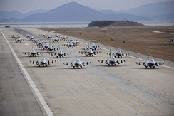 F-16's from the 8th and 419th Fighter Wings awaiting takeoff, in an elephant walk formation.