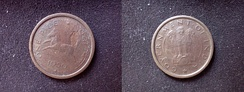 Both sides of copper-coloured coin