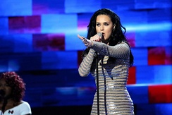 "Katy Perry appeared during the final night of the convention, performing ""Rise"" and ""Roar"" with lightly modified lyrics voicing support for Hillary Clinton."