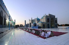 "Men praying during Ramadan at the Shrine of Ali or ""Blue Mosque"" in Mazar-i-Sharif, Afghanistan"
