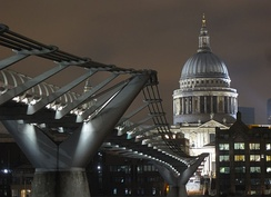 St Paul's illuminated, with the Millennium Bridge in the foreground