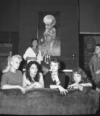 "The news photo caption for this 1959 event in Venice, California read: ""Beatnik Beauties: Posing before a sample of beatnik art are contestants for the title of Miss Beatnik of 1959, which will be conferred Sept. 12 under sponsorship of the Venice Arts Committee. From left are Michi Monteef, Sammy McCord, Patti McCrory, Shaunna Lea and, in rear, Jan Vandaveer.""[15]"