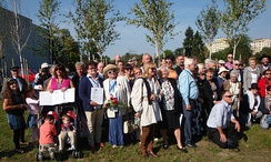 The Polish rescuers and the Jewish survivors plant Trees of Memory during the ceremony at the Park of the Rescued Park Ocalałych w Łodzi [pl] inaugurated in Łódź in August 2009