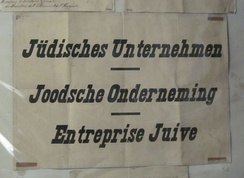 Trilingual (German-Dutch-French) signs used to mark Jewish-owned shops and businesses in Belgium from October 1940