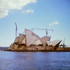 Sydney Opera House, still under construction in 1966, three years after its expected completion date