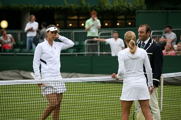Tsvetana Pironkova and Jill Craybas during the coin toss, before their 2009 Wimbledon Championships first round.