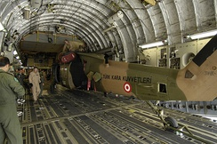 A Turkish Land Forces UH-60 inside of a Boeing C-17 Globemaster III while being transported to Afghanistan in order to support  Operation Enduring Freedom.