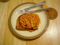Vegetarian sausages with baked beans on toast