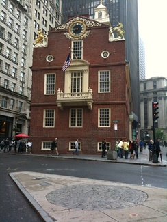 View of the Old State House, Boston, Massachusetts, the seat of British colonial government from 1713 to 1776. The Boston Massacre took place in front of the balcony, and the site is now marked by a cobblestone circle in the square (photo 2009).