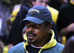 Candid head and shoulders photograph of Rashad wearing a baseball cap bearing the Oregon Ducks logo