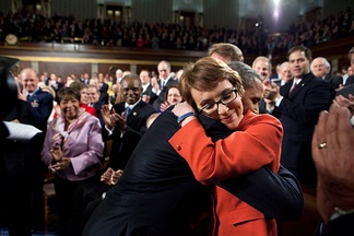 After delivering the 2012 State of the Union Address on January 24, 2012, President Obama embraces Congresswoman Gabrielle Giffords, who had been shot the previous year.