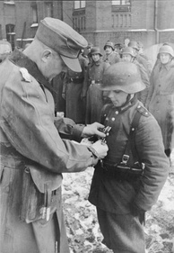March 1945: Photo of 16-year-old Willi Hübner being awarded the Iron Cross II Class medal for his defense of Lauban