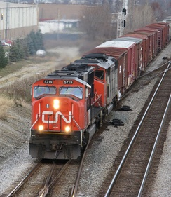 Two Canadian National diesel locomotives pull a southbound freight train on the Norfolk-Southern railroad, near Columbus, Ohio in the United States