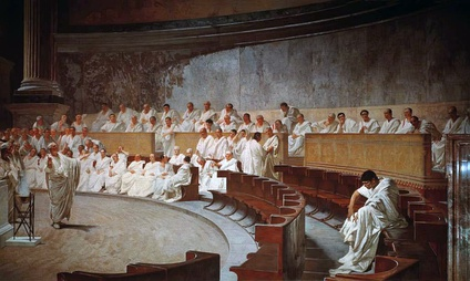 Representation of a sitting of the Roman senate: Cicero attacks Catiline, from a 19th-century fresco in Palazzo Madama, Rome, house of the Italian Senate. It is worth noting that idealistic medieval and subsequent artistic depictions of the Senate in session are almost uniformly inaccurate. Illustrations commonly show the senators arranged in a semicircle around an open space where orators were deemed to stand; in reality the structure of the existing Curia Julia building, which dates in its current form from the Emperor Diocletian, shows that the senators sat in straight and parallel lines on either side of the interior of the building. In current media depictions in film this is shown correctly in The Fall of the Roman Empire, and incorrectly in, for example, Spartacus.