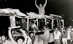 Students in a burned bus during the protests of 1968