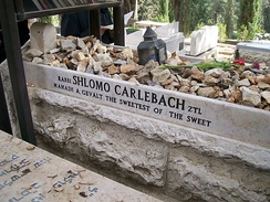 The grave of rabbi-singer Shlomo Carlebach in Jerusalem is piled with stones left by visitors.