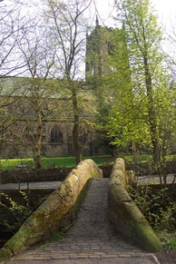 Mellor Bridge, one of Marsden's two packhorse bridges, with St Bartholomew's Church in the background