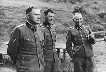 From the Höcker Album (left to right): Richard Baer (Auschwitz commandant from May 1944), Josef Mengele (camp physician), and Rudolf Höss (first commandant) in Solahütte, an SS resort near Auschwitz, summer 1944.[88]