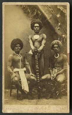Three Kai Colo men in traditional Fijian attire