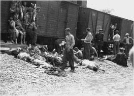 Bodies being pulled out of a train carrying Romanian Jews from the Iași pogrom