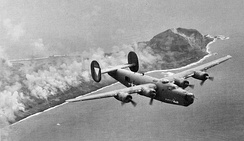 Squadron B-24J flying over Iwo Jima on 6 March 1945[note 1]