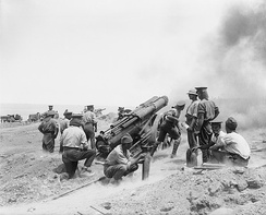 A British 60-pounder (5-inch (130 mm)) gun at full recoil, in action during the Battle of Gallipoli, 1915. Photo by Ernest Brooks.