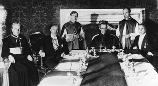 Pacelli (seated, center) at the signing of the Reichskonkordat on 20 July 1933 in Rome with (from left to right): German prelate Ludwig Kaas, German Vice-Chancellor Franz von Papen, Secretary of Extraordinary Ecclesiastical Affairs Giuseppe Pizzardo, Alfredo Ottaviani, and Reich minister Rudolf Buttmann