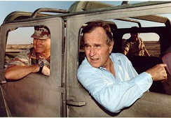 General Norman Schwarzkopf, Jr. and President George Bush visit US troops in Saudi Arabia on Thanksgiving Day, 1990.