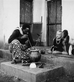 A man drinking pombe on the porch of Bonno Thoden van Velzen (Ibala village, 1967).