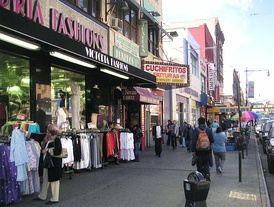 "Storefronts at Lexington Avenue and 116th Street at East Harlem, Manhattan, also known as Spanish Harlem or ""El Barrio"""