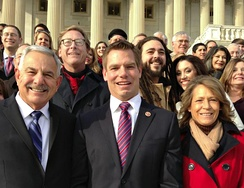 Representative Eric Swalwell on the Capitol Hill steps with friends, family, and campaign staff, 2013