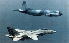 A U.S. Navy F-14 Tomcat escorts an Iranian P-3F Orion over the Indian Ocean – 1981