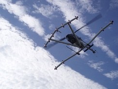 This helicopter is equipped with a magnetometer array. It flies six feet above ground at speeds of 30 to 40 mph.