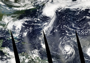 Three simultaneous tropical cyclones on September 7, Henri (left), Fabian (center) and Isabel (right).