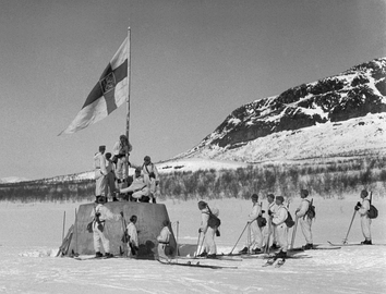 Finnish soldiers raise the flag at the three-country cairn between Norway, Sweden and Finland on 27 April 1945, which marked the end of World War II in Finland.