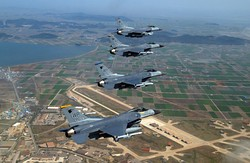 F-16C Fighting Falcons of the 8th Fighter Wing flying over Kunsan Air Base.