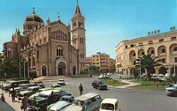 The old Tripoli Cathedral (now a mosque) and the former FIAT centre (Algeria Square) during the 1960s